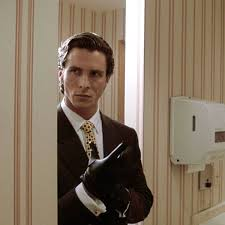 Patrick Bateman from American psycho puts on gloves.