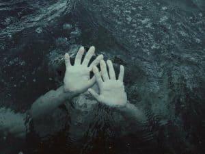 woman sinking under water